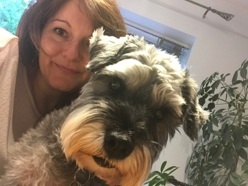 Woman and Mini Schnauzer dog